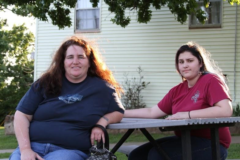 Verna Morales, left, and her daughter, Aliah Morales, sit in front of their old transitional apartment at Pearl's Hope, a homeless shelter in Tulsa.  Aliah Morales has been homeless for three years and her mother has been homeless for six years. The two c