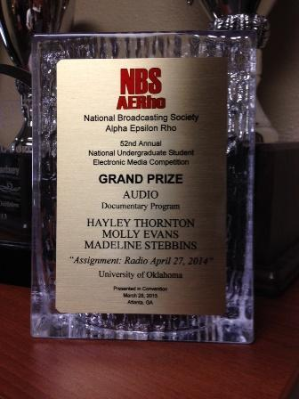 "The Grand Prize for Audio Documentary Program from teh National Broadcasting Society, given to KGOU students Hayley Thornton, Molly Evans and Madeline Stebbins for their April 27, 2014 ""Assignment Radio"" program."