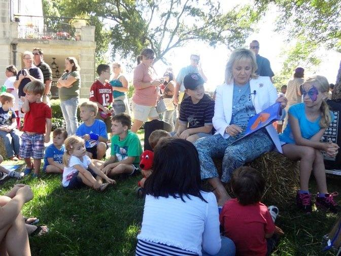 Gov. Mary Fallin reads to children on the lawn of the governor's mansion in Oklahoma City in September 2012.