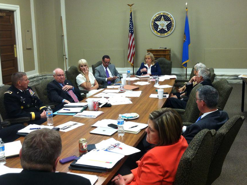 Gov. Mary Fallin meets with cabinet secretaries and emergency management officials at the state Capitol Tuesday to discuss May storm damage.