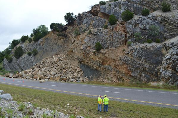 Oklahoma Department of Transportation crews assess Thursday's rock slide along Interstate 35 northbound in Murray County near Davis.
