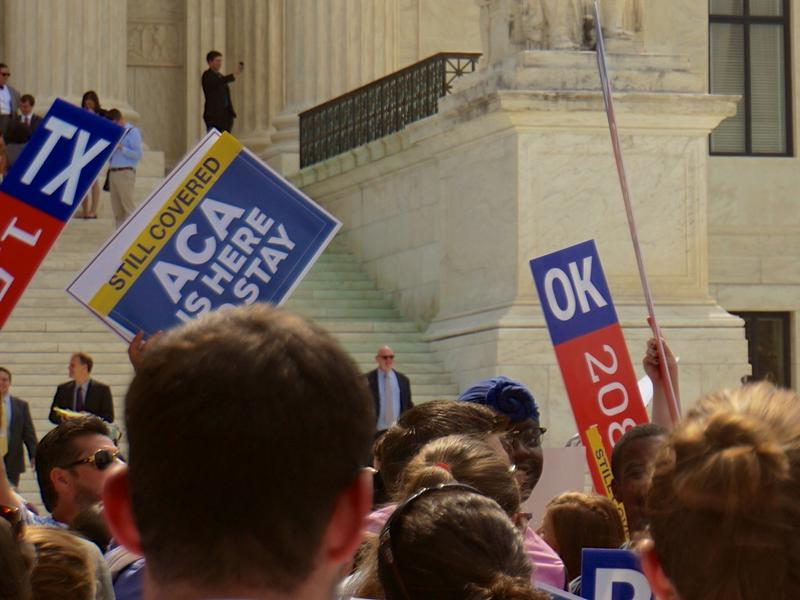 Demonstrators gather outside the Supreme Court on Thursday after the ruling that Affordable Care Act subsidies are constitutional.