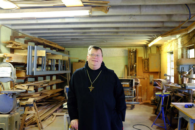 Lawrence Stasyszen, abbott of St. Gregory's Abbey, stands inside the monastery's condemned workshop in Shawnee, Okla. The monastery and nearby college are still reeling from millions in damage from a 5.7-magnitude quake that struck in 2011.