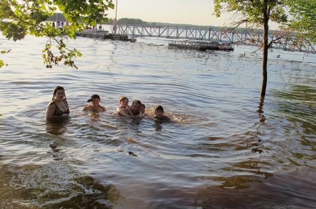 Justin Stratford and several of his nieces and nephews play in Lake Thunderbird on a road trip from Arizona.