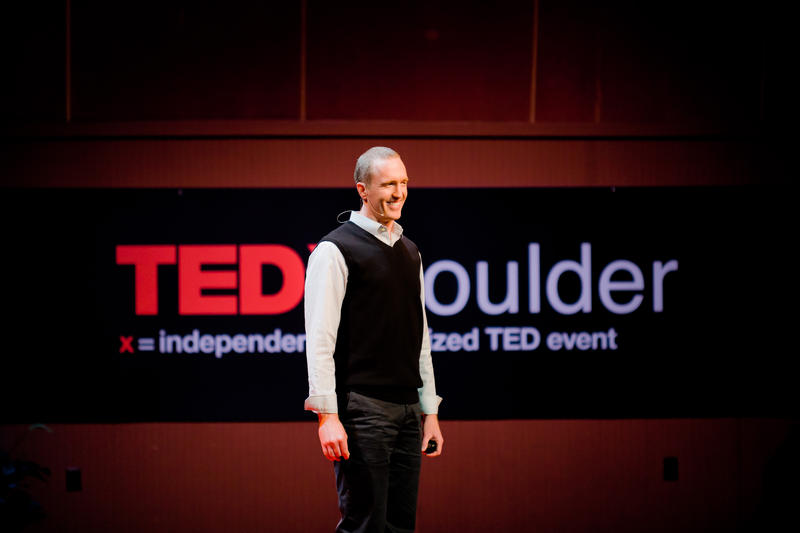 Peter McGraw speaking at TEDxBoulder in 2010.