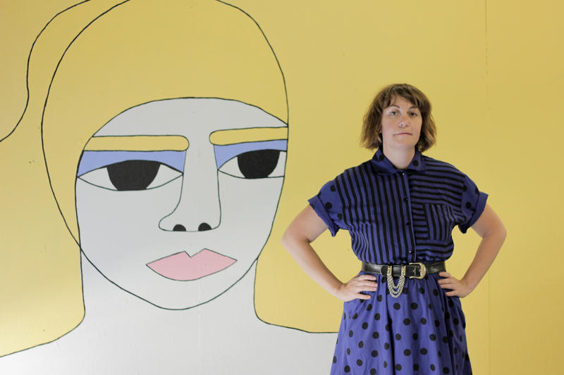 Melissa Jacobs poses with a mural created for her one-night, one-woman show Sunday, June 7 at Tall Hill Creative.
