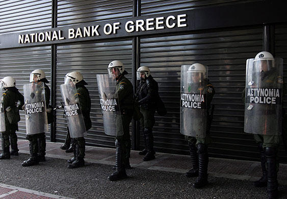 Police guard the National Bank of Greece in Athens. Undated, uploaded Feb. 13, 2015.