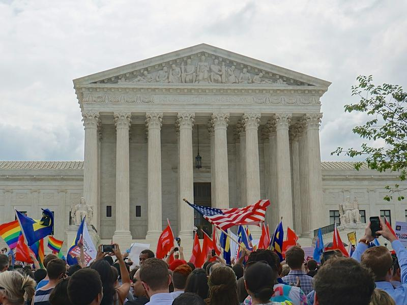 Demonstrators gather outside the U.S. Supreme Court building in Washington, D.C. after Friday's ruling legalizing same-sex marriage in all 50 states.