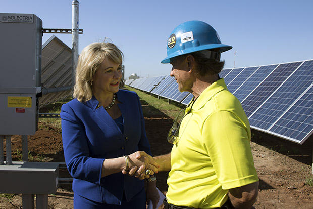 Gov. Mary Fallin meets with a worker at a July 2015 event commemorating Oklahoma Gas & Electric's new solar farm in Oklahoma City.