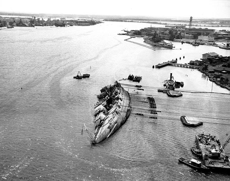 The USS Oklahoma (BB-37) righted to about 30 degrees during the salvage operation at Pearl Harbor, March 29, 1943.
