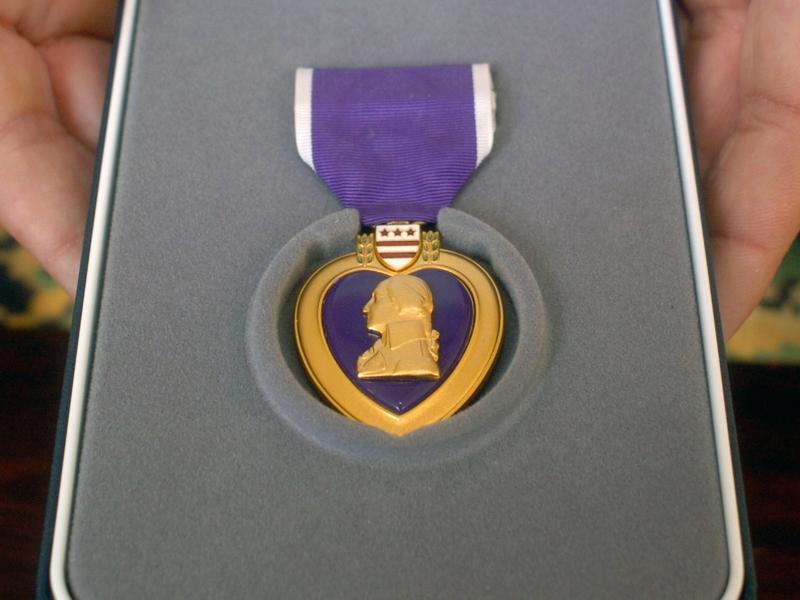 purple heart medal in a case
