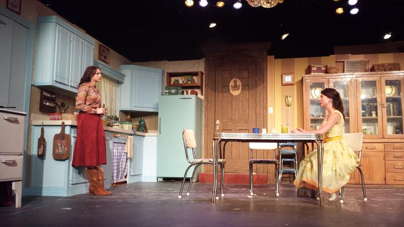 "Two sisters drinking fresh-squeezed lemonade: Meg (Kelsey Godfrey) listens to Babe (Chandler Ryan) talk about her husband's abuse in ""Crimes of the Heart."""