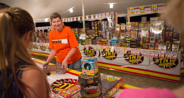 Cheryl Hooper sells TNT Fireworks from her stand near Route 66 and Westminster Road in Arcadia.