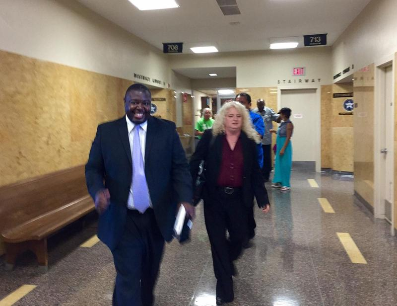 Marq Lewis with We The People Oklahoma walks out of the courtroom with his attorney, Laurie Phillips, after a judge ruled signatures collected in support of a grand jury investigation of the Tulsa County Sheriff's Office are sufficient.