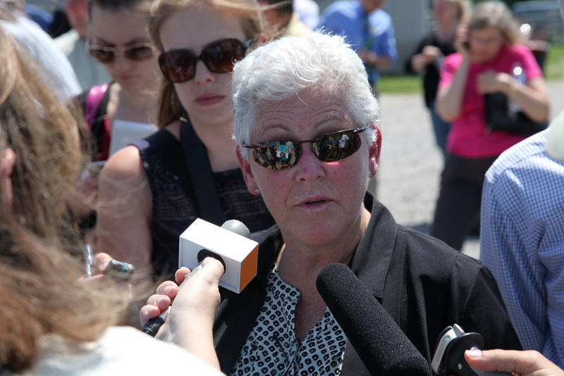 EPA Administrator Gina McCarthy speaks to reporters while on a farm tour in Rocheport, Mo., in 2014.