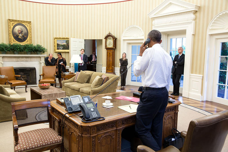 President Barack Obama talks on the phone in the Oval Office with Secretary of State John Kerry to thank him for his work with the negotiations on the nuclear agreement with Iran, July 13, 2015.