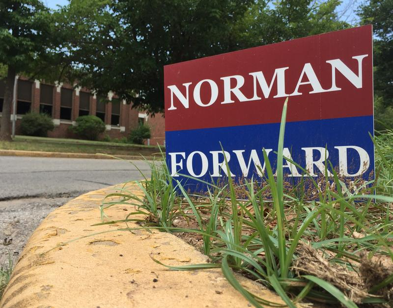 A Norman Forward sign on Flood Ave. across from McKinley Elementary.