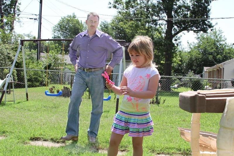 Michael Lockhoff plays with his daughter in their backyard in Tulsa. The Lockhoffs struggled last year, when she was 6, to work with schools to meet their child's educational and emotional needs.