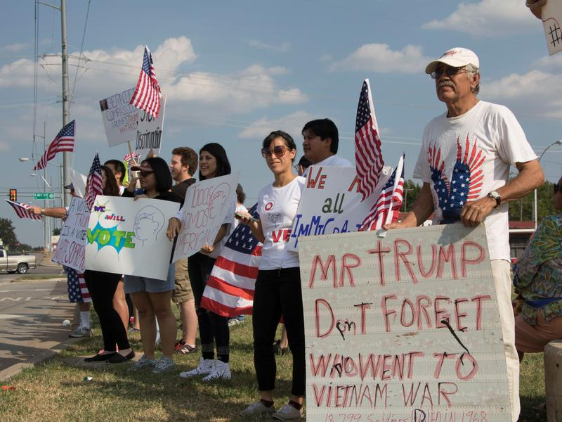 Protesters of Donald Trump's visit gather at the intersetion of NW 10th Street and May Ave. just to the north of the Oklahoma State Fairgrounds.