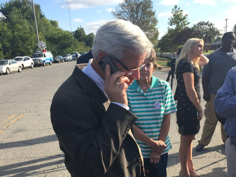 Attorney Don Knight on the phone with Richard Glossip outside the Oklahoma State Penitentiary in McAlester.
