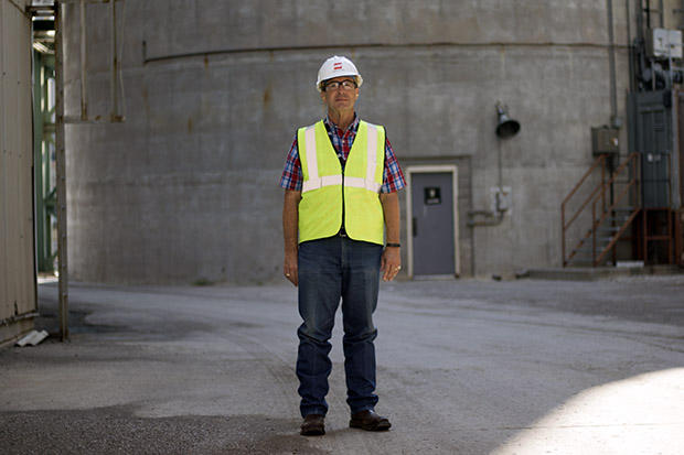 Northeast Station Manager Mark Barton at the base of the stack for coal-fired power units 3 and 4.