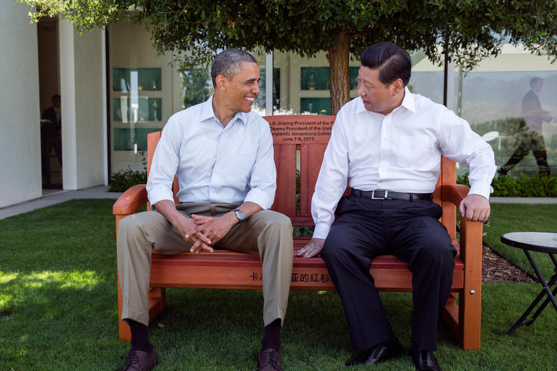 President Barack Obama presents President Xi Jinping of the People's Republic of China with a gift of an inscribed redwood park bench at the Annenberg Retreat at Sunnylands in Rancho Mirage, Calif., June 8, 2013.