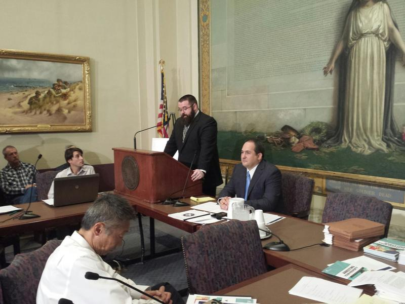 Cato Institute attorney Adam Bates testifies at a special hearing on civil asset forfeiture at the state Capitol, Sept. 1, 2015. State Sen. Kyle Loveless is seated to the right.