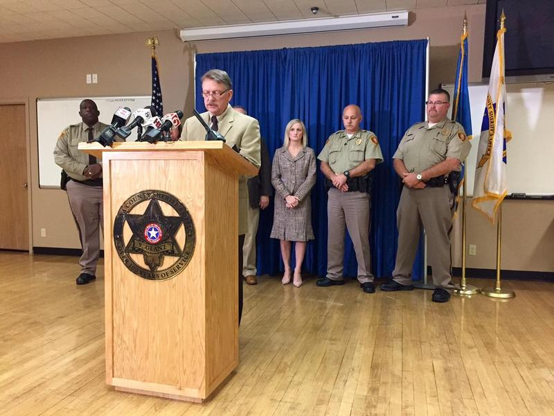Undersheriff Rick Weigel, accompanied by administrative staff of the Tulsa County Sheriff's Office, gives a statement at a news conference October 1, 2015.