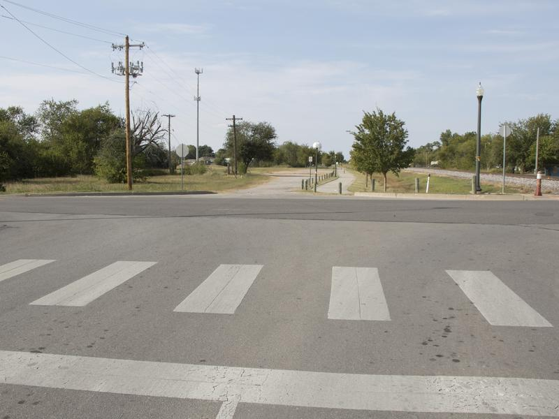 The current terminus of James Garner Ave. at Acres Street. Norman Forward would extend the two-lane roadway all the way to the Robinson Street underpass.