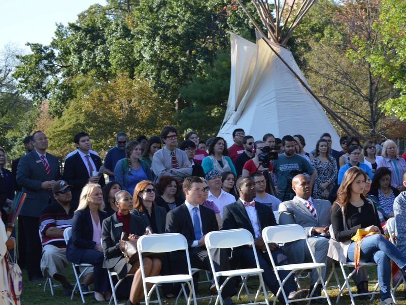 A crowd gathers on the University of Oklahoma's South Oval October 12, 2015 to mark the first Indigenous Peoples' Day on campus.