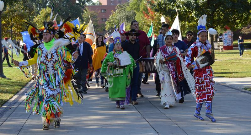 Native American students and school administrators march down the South Oval toward Bizzell Memorial Library October 12, 2015 morning to mark the first Indigenous Peoples' Day at the University of Oklahoma.