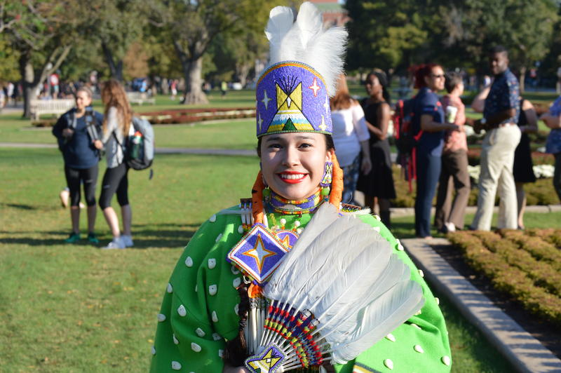 Native American student Raven Morgan, dressed in a traditional Southern Cheynne elktooth gown.