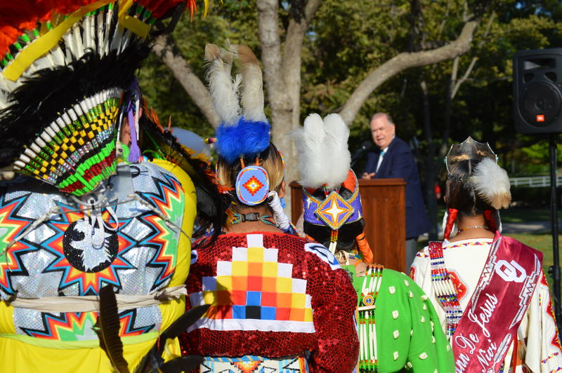 Native American students in traditional dress listen as University of Oklahoma president David Boren marks OU's first Indigenous Peoples' Day, Ocotber 12, 2015
