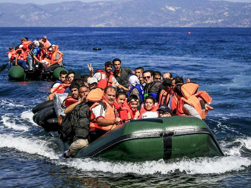 Syrian refguees arrive on the Mediterranean coast, Sept. 2015.
