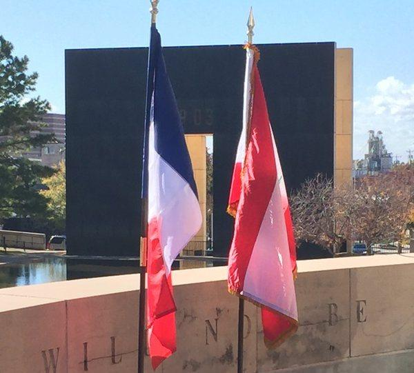 French and Lebanese flags fly at the Oklahoma City National Memorial on Tuesday.