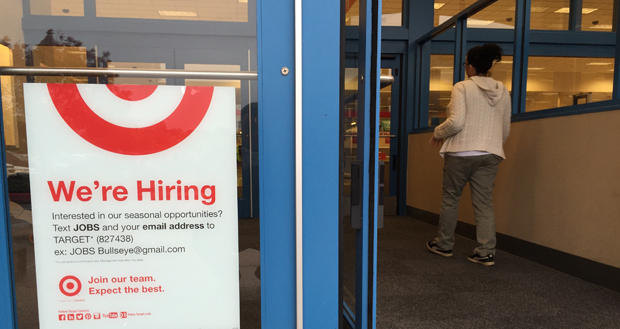 A sign advertising job opportunities is displayed at the entrance of a Target store at 1200 E. Second St. in Edmond.