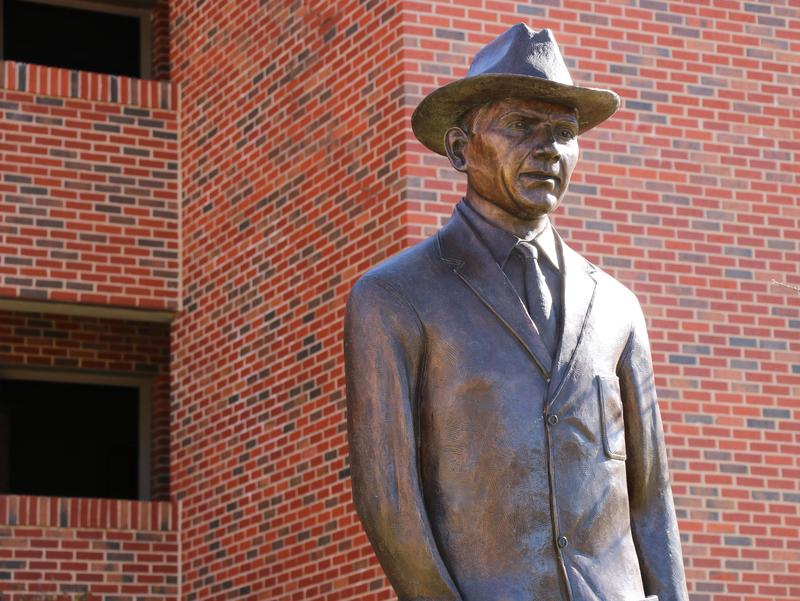 The statue of Bennie Owen stands in front of athletic dorms on the east side of Oklahoma Memorial Stadium, which Owen helped build in the early 1920s.