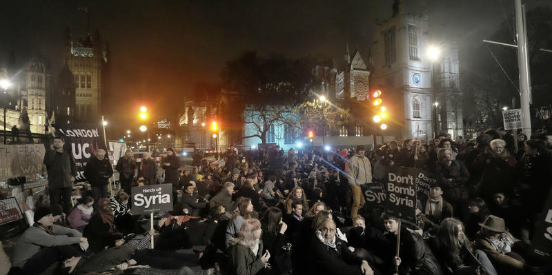 British protesters gather for a sit-in in London's Parliament Square Dec. 1, 2015 ahead of a vote to authorize increased military intervention in Syria.
