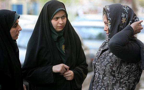 Women in various states of dress on the streets of Iran.