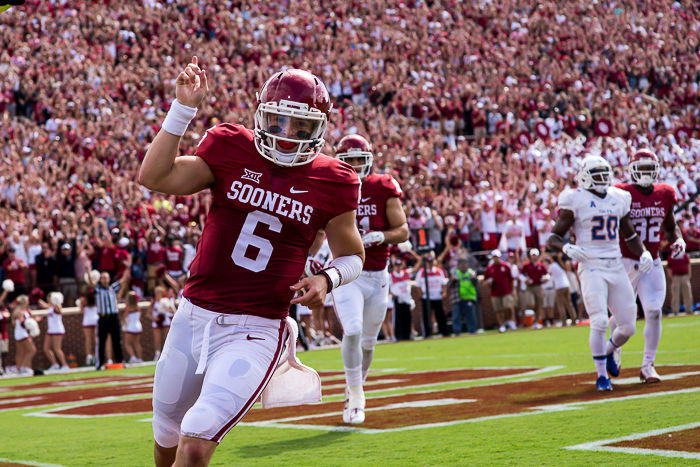 Junior quarterback Baker Mayfield celebrates after scoring a touchdown at Gaylord Memorial Stadium, Saturday, Sep. 19, 2015.