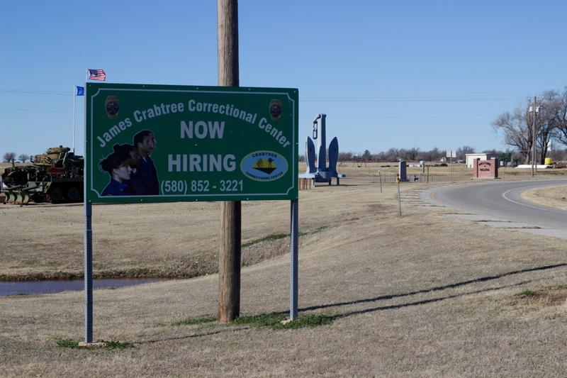 A sign advertising career opportunities at the prison in Helena, Oklahoma