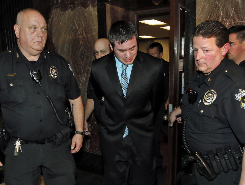 Former Oklahoma City police officer Daniel Holtzclaw cries as he is led from the courtroom after the verdicts were read for the charges against him at the Oklahoma County Courthouse on December 10, 2015.