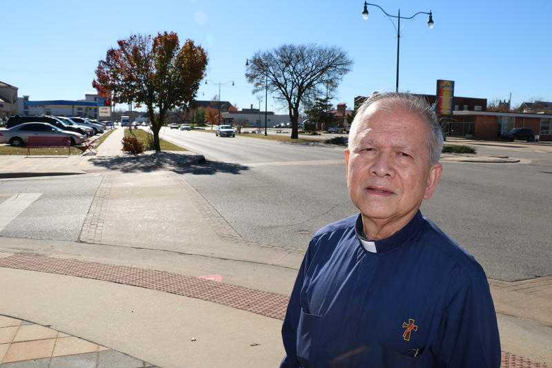 San Nguyen stands along Classen Blvd. in Oklahoma City's Asian District.