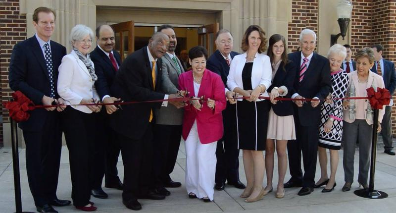 Dean Grillot helps cut ribbon opening new College of International Studies building