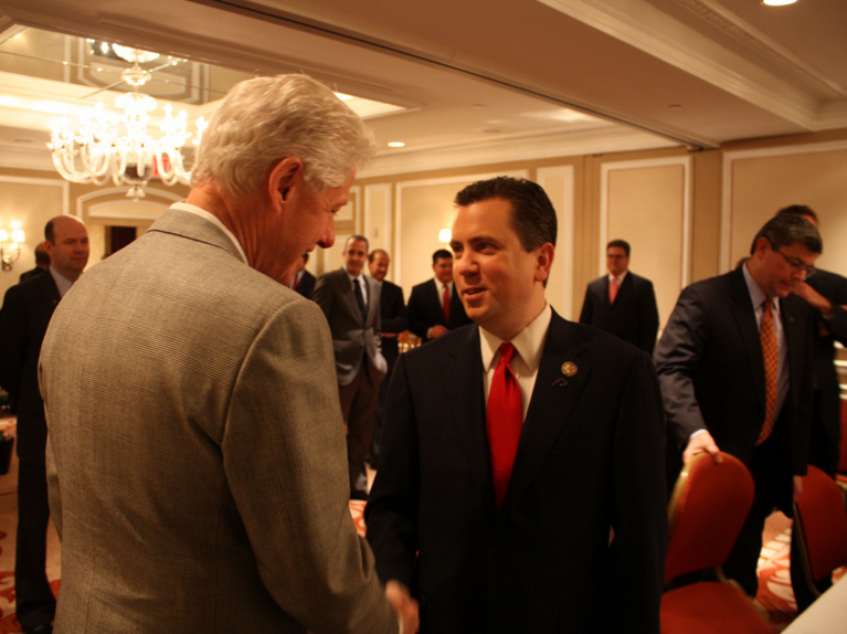 Then-U.S. Rep. Dan Boren talking with former President Bill Clinton during a 2011 meeting of the Blue Dog Coalition of conservative Democrats in New York.