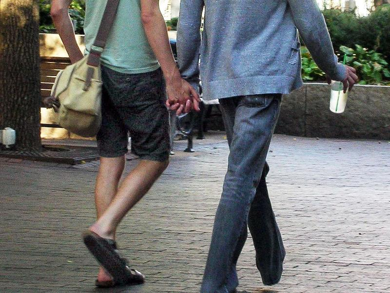 two gay men holding hands
