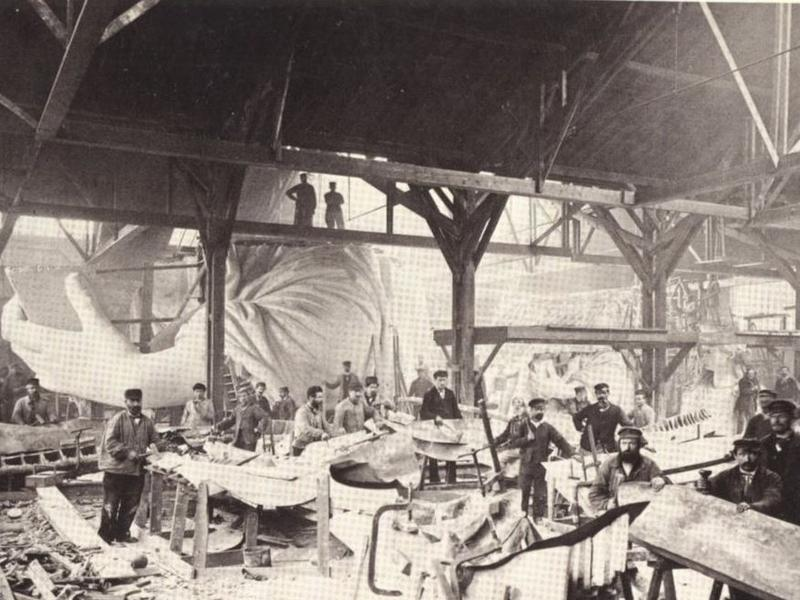 Craftsmen in Paris work on the construction of the Statue of Liberty.