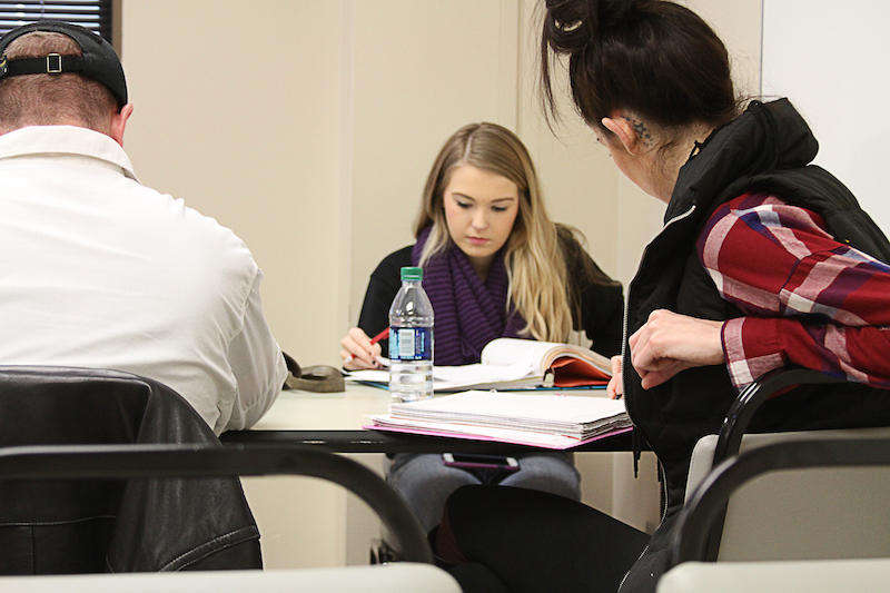 Tulsa Community College freshman Zoey Radcliffe, center, looks at her notes while preparing for a final in her remedial math course. Thousands of Oklahomans take remedial college courses each year to relearn content they should have learned in high school