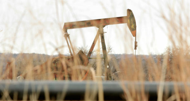 A pump jack at an oil-field site near Luther.