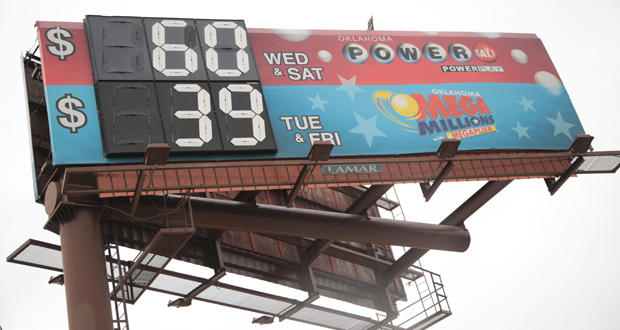 A billboard along Interstate 35 in Oklahoma City advertises the latest Powerball and Mega Millions lottery jackpots on Thursday.